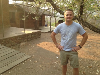 Colton in front of his home in Rukwa