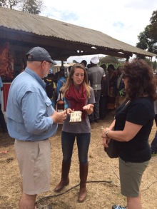 Explaining something to my parents at the local festival in Arusha