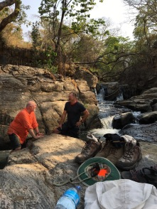 Dad and Ted talking at the waterfalls behind the Rabenold's house
