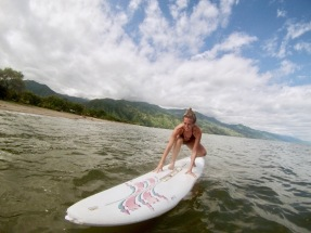 Trying to 'surf' with a random board we found at Matema - Lake Malawi