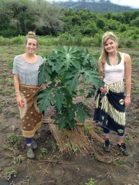 Colton's sister and I with a papaya tree