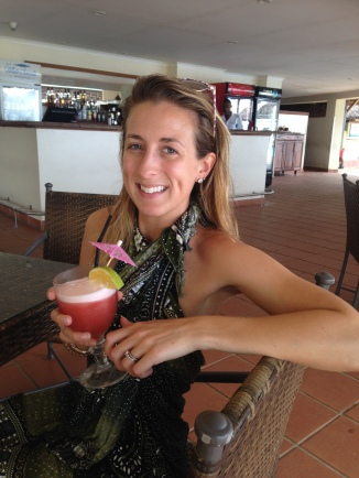 Enjoying a fruity cocktail while hiding from the rain in Dar!