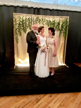 Mom and Dad with the bride